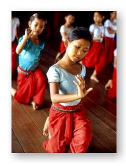 Cambodian American girls practicing traditional dance © Bruno Morandi and Getty Images