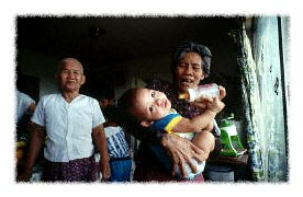 Cambodian grandparents and their grandbaby � David H. Wells/Corbis