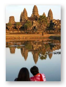 Cambodian couple in front of Angkor Wat Temples ©  	 Wilfried Krecichwost and Getty Images